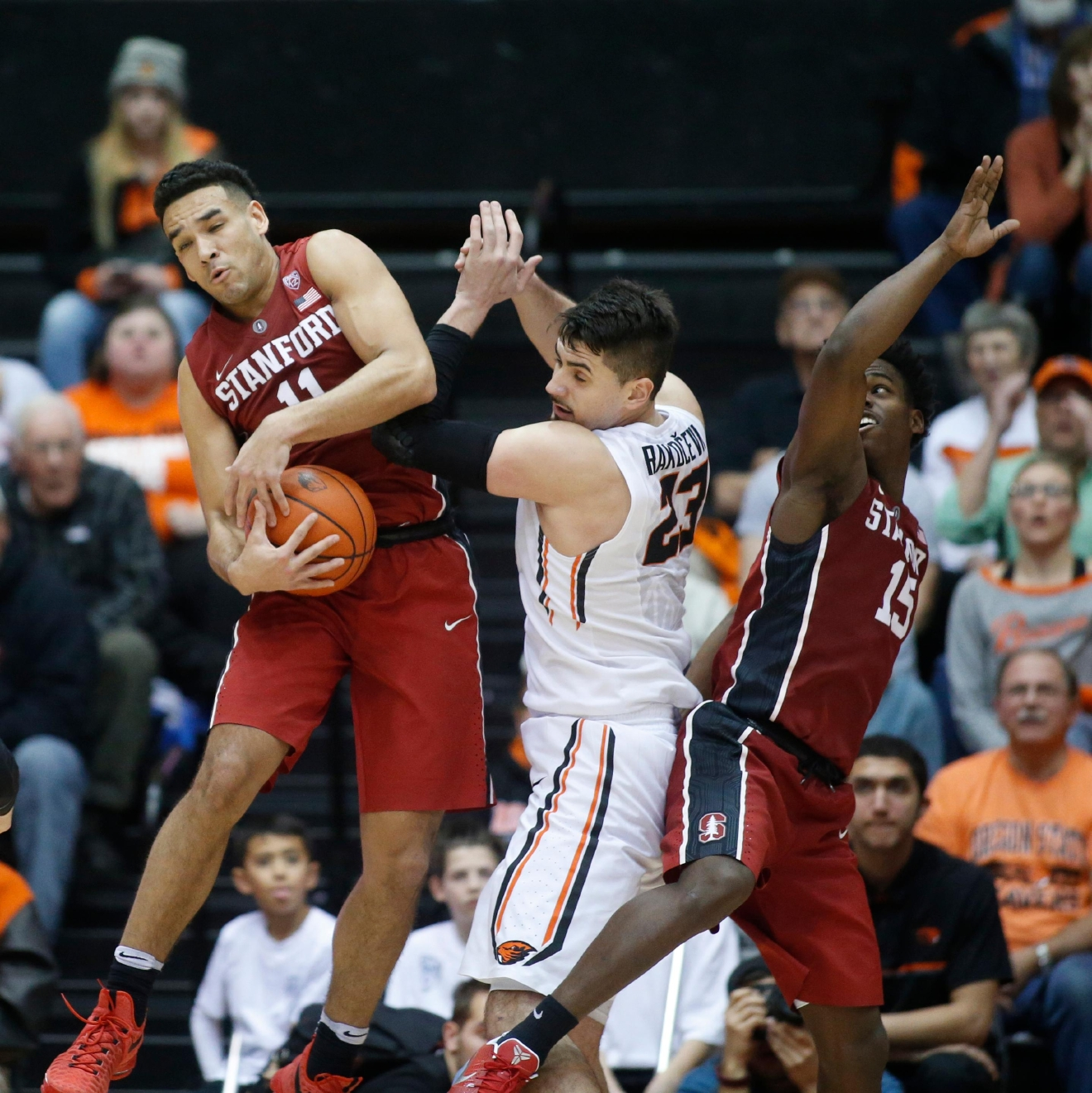 Stanford's Dorian Pickens, left, grabs a rebound away from Oregon State's Gligorije Rakocevic, center, and Stanford's Marcus Allen, right, during the second half of an NCAA college basketball game in Corvallis, Ore., Thursday, Jan. 19, 2017. Stanford won 62-46. (AP Photo/Timothy J. Gonzalez)
