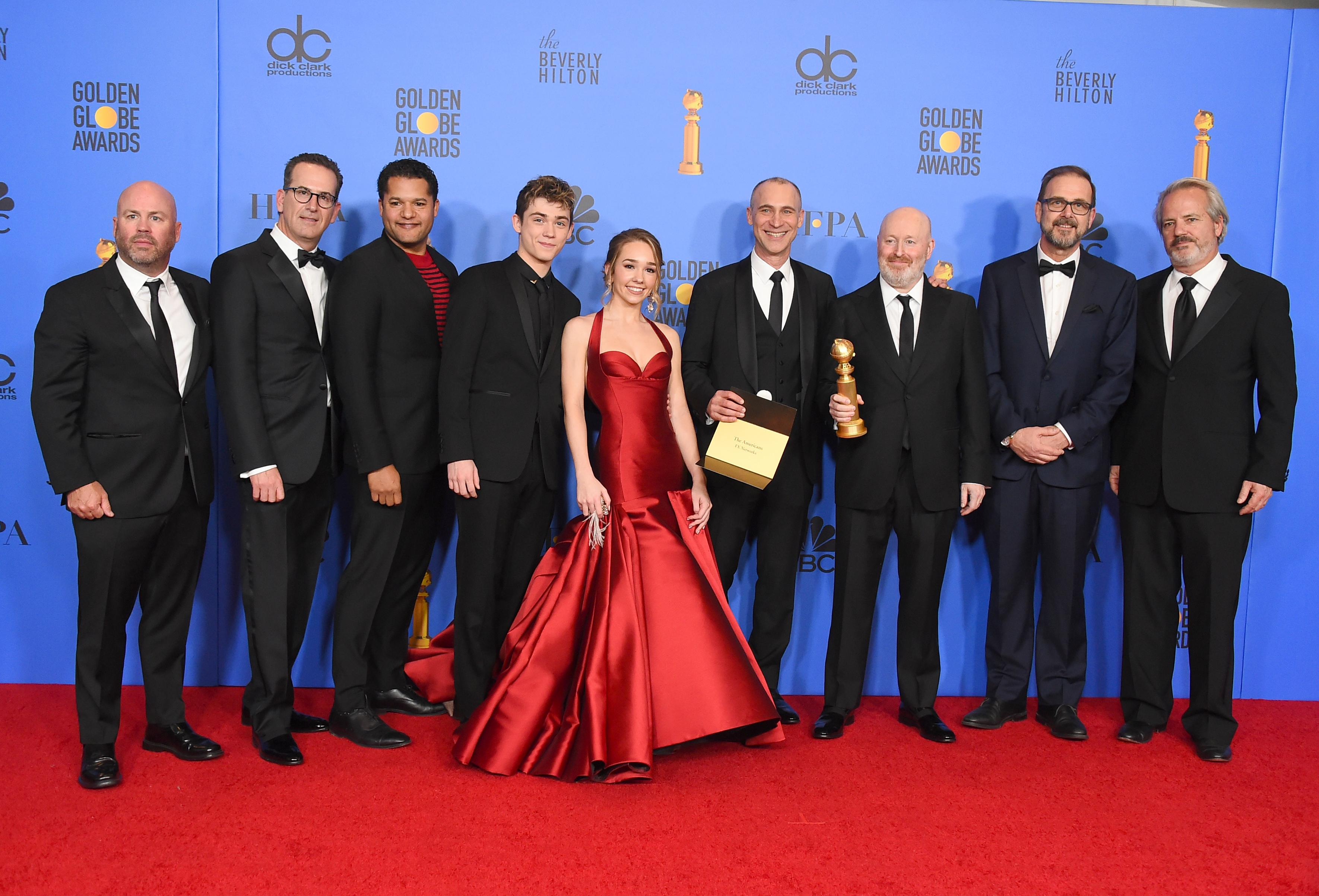 "The cast and crew of ""The Americans"" pose in the press room with the award for best television series, drama at the 76th annual Golden Globe Awards at the Beverly Hilton Hotel on Sunday, Jan. 6, 2019, in Beverly Hills, Calif. (Photo by Jordan Strauss/Invision/AP)"