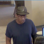 FBI: Suspect holds up sign demanding money in bank robbery