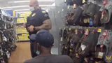 Police officers take homeless Navy vet shopping