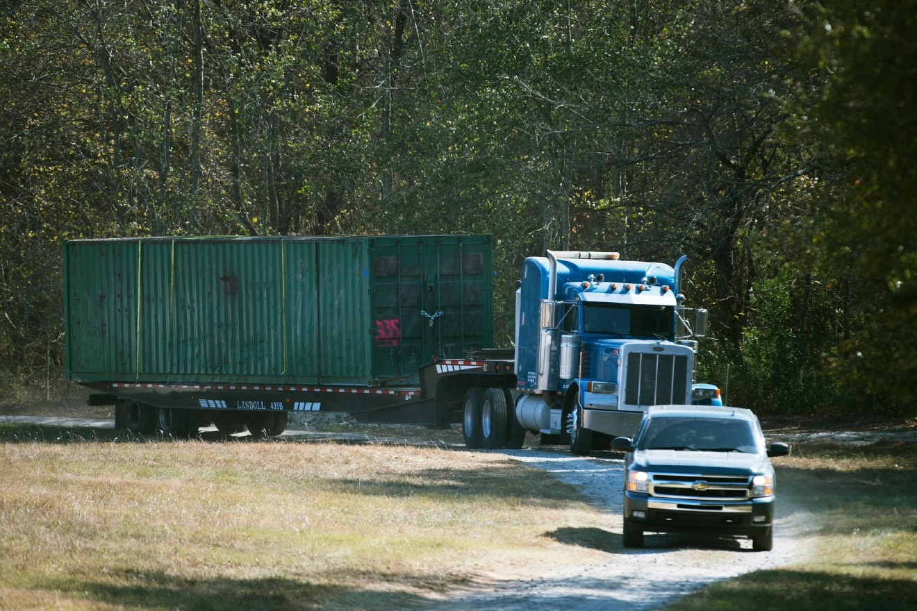FILE - In this Wednesday, Nov. 9, 2016 file photo, the shipping container that an abducted woman was held in for two months is removed from Todd Kohlhepp's property in Woodruff, S.C. A South Carolina woman who spent two months chained inside a metal container says her captor bragged that he was good at killing people and warned her she could be next if she fought back or ran. (Lauren Petracca/The Greenville News via AP, File)