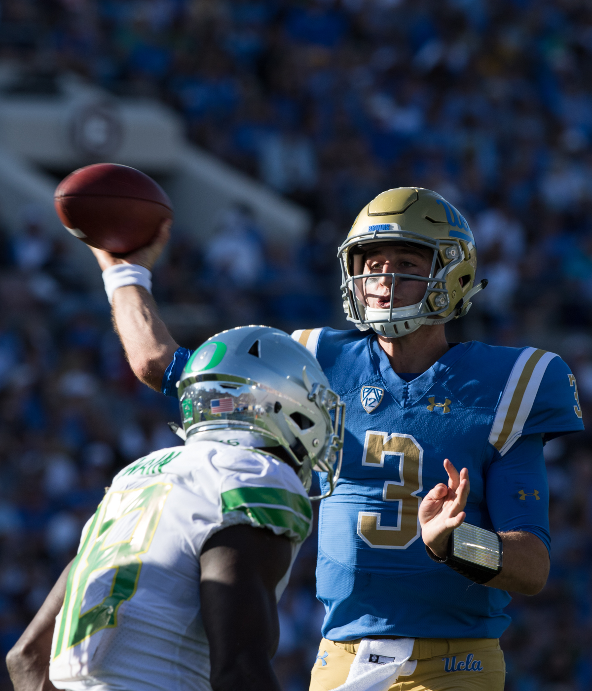 UCLA quarterback Josh Rosen (#3) throws a touchdown pass over Oregon linebacker Jimmie Swain (#18). The Oregon Ducks fell to the UCLA Bruins 14-31 after being shut out during the second half at the Rose Bowl Stadium in Pasadena, California.  This marks the third consecutive loss for the Ducks, dropping their record to 4-4 on the season.  Photo by Austin Hicks, Oregon News Lab