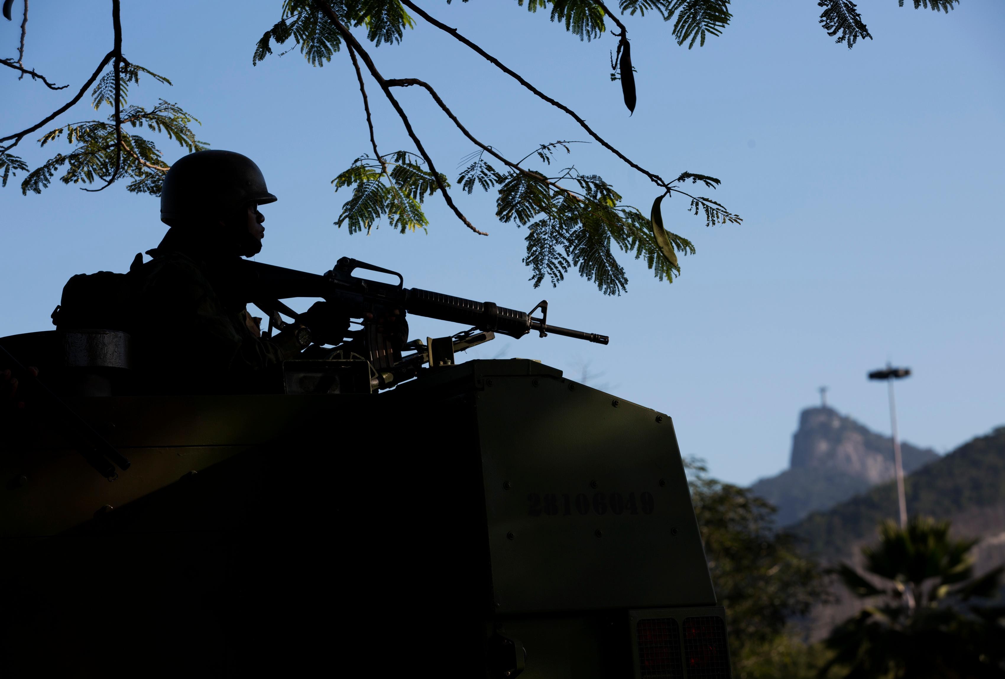 A Navy soldier patrols near the Santos Dumont Airport in Rio de Janeiro, Brazil, Friday, July 28, 2017.  Thousands of Brazilian soldiers have begun patrolling in Rio de Janeiro amid a spike in violence. (AP Photo/Silvia Izquierdo)
