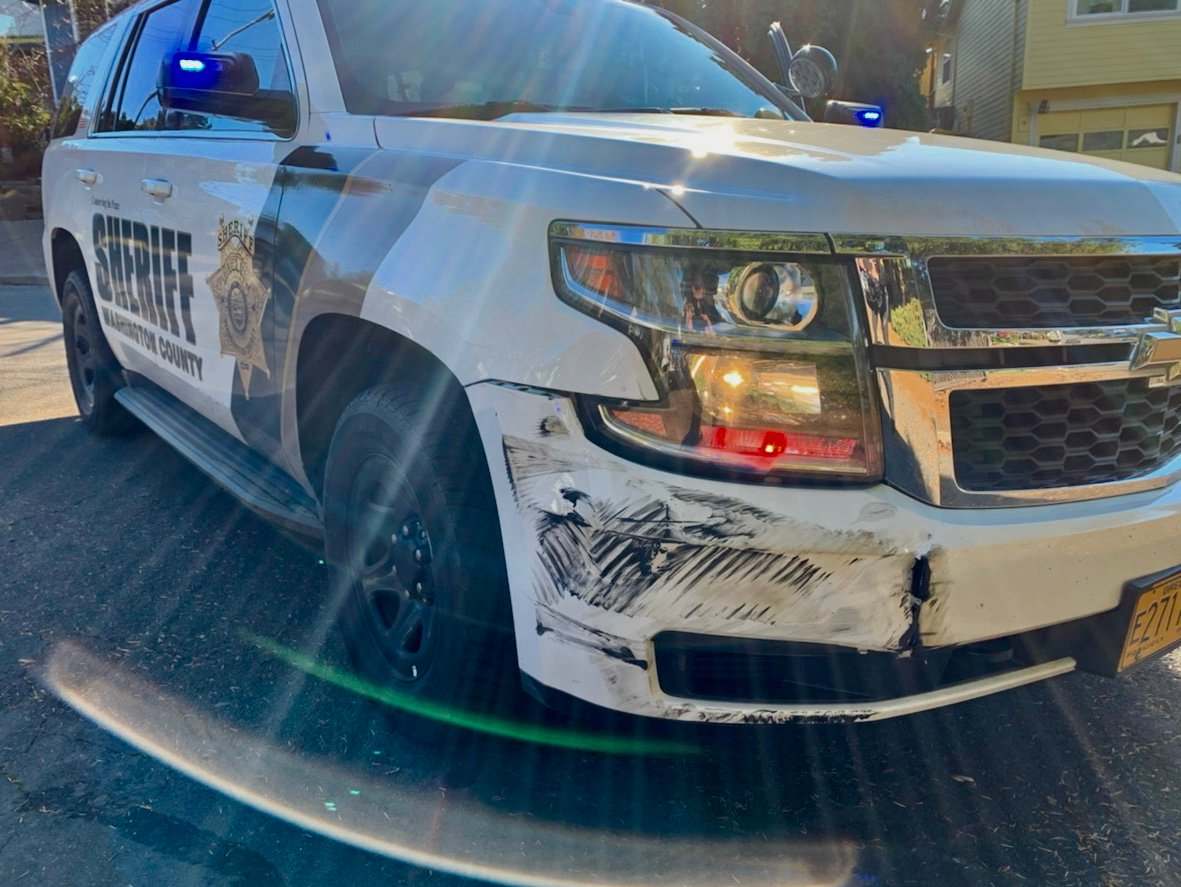 The Washington County Sheriff's Office said a man rammed into two patrol vehicles and crashed into a house before barricading himself in a home in Aloha on Nov. 21, 2019. Photo courtesy Washington County Sheriff's Office