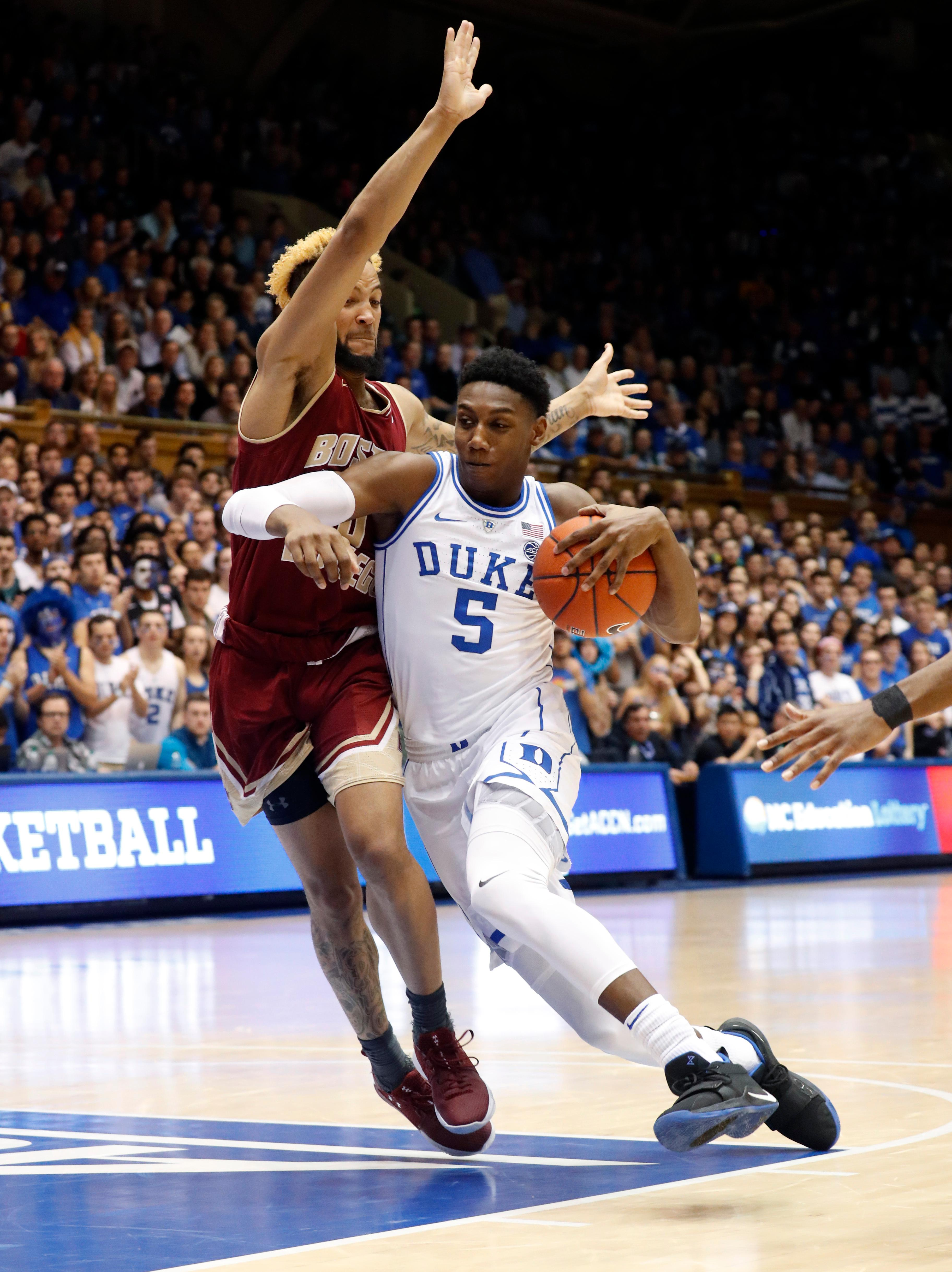Duke's RJ Barrett (5) is defended by Boston College's Ky Bowman (0) during the second half of an NCAA college basketball game against Duke in Durham, N.C., Tuesday, Feb. 5, 2019. (AP Photo/Chris Seward)