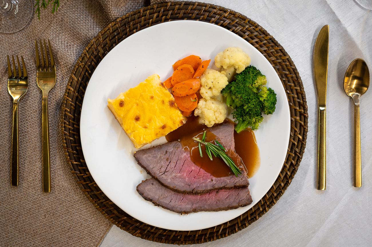 The Holiday Dinner Buffet. Pictured: house rubbed roast beef with savory glaze, au gratin potatoes, broccoli, cauliflower, and carrots. / Image: Phil Armstrong, Cincinnati Refined // Published: 11.6.20