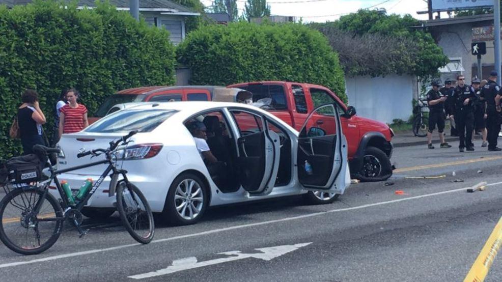stolen car crashes in seattle police make one arrest