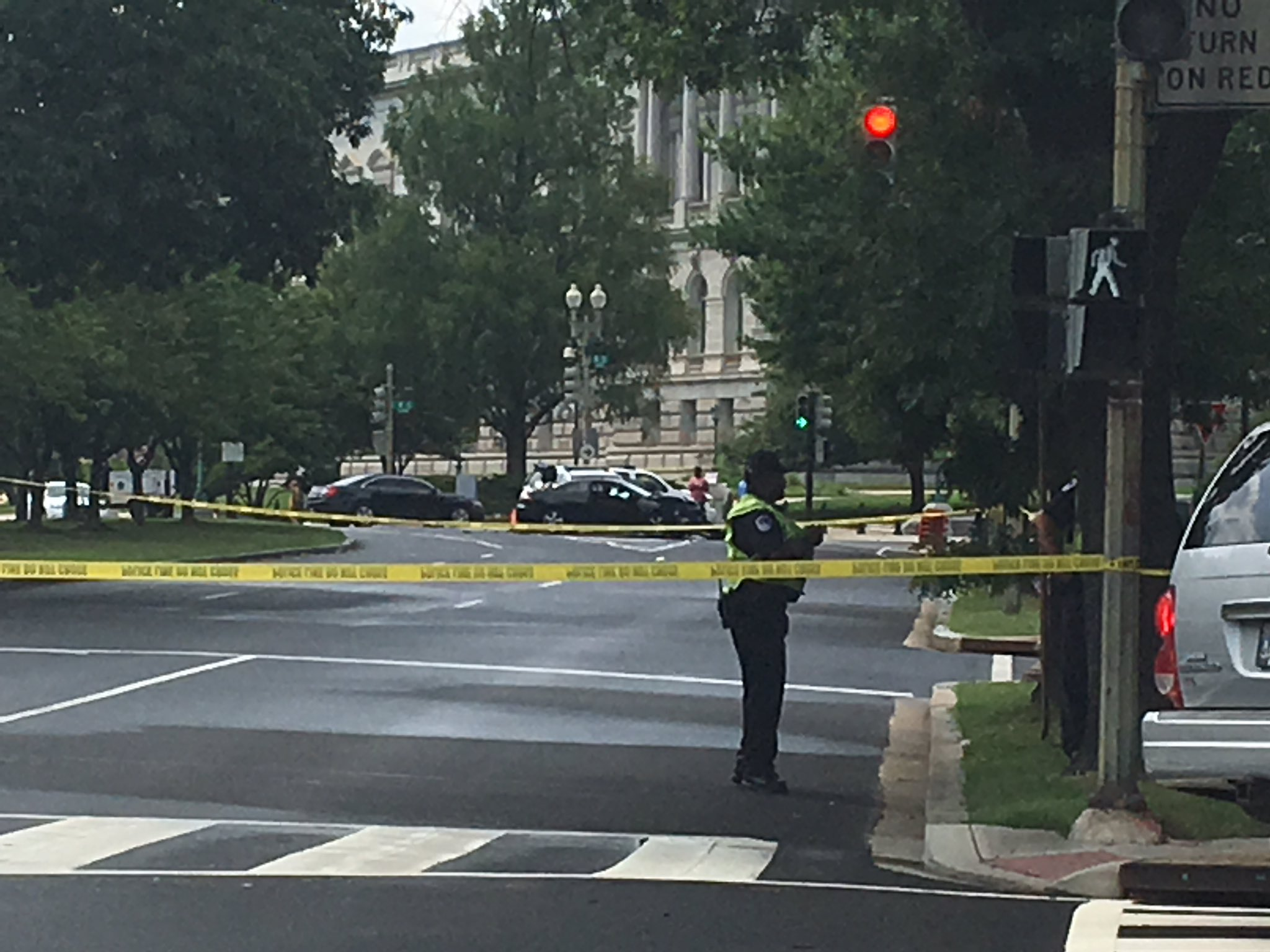 Black car at center of pic with trunk open focus of investigation near U.S. Capitol, Monday, July 17, 2017 (Nathan Baca/ABC7)