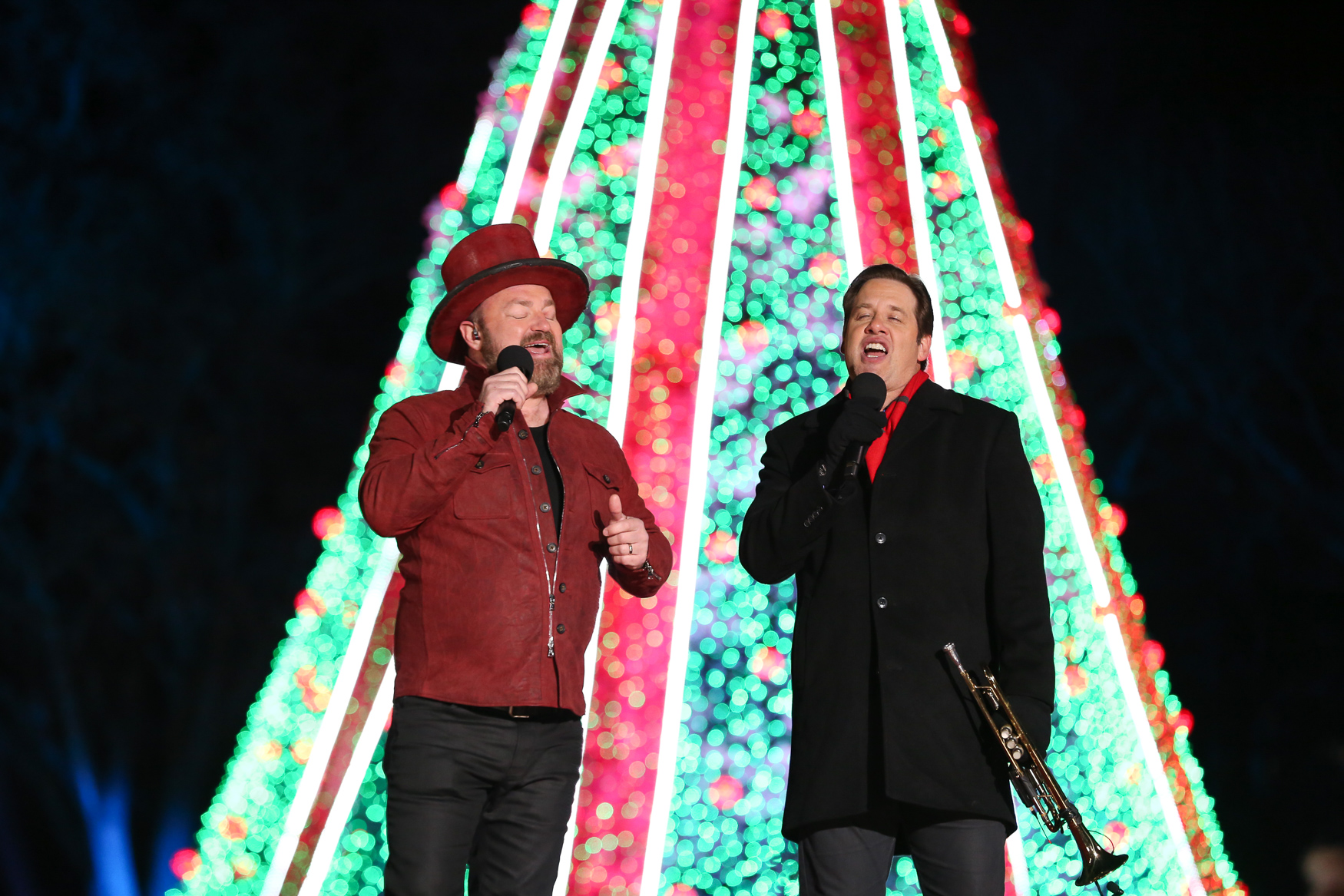 Despite frigid cold, the 2018 National Christmas Tree was illuminated by President Donald Trump and First Lady Melania Trump on November 28. The talent for the evening included some lesser-known acts, but they tried to rouse the holiday spirit with familiar Christmas carols. The festivities were hosted by Antonio Sabato Jr., a former model and soap opera store who supported President Trump during his 2016 campaign.  The celebration will be broadcast on Ovation or REELZ on December 2 at 10 p.m. EST. (Amanda Andrade-Rhoades/DC Refined)