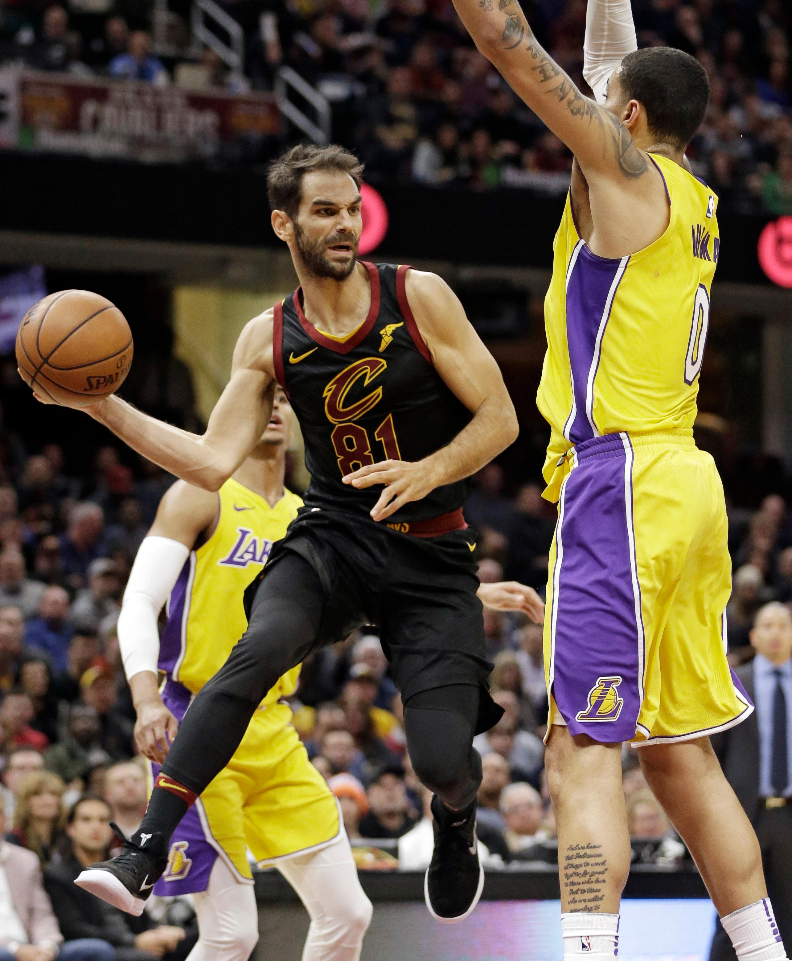 Cleveland Cavaliers' Jose Calderon (81), from Spain, looks to pass against Los Angeles Lakers' Kyle Kuzma (0) in the first half of an NBA basketball game, Thursday, Dec. 14, 2017, in Cleveland. (AP Photo/Tony Dejak)