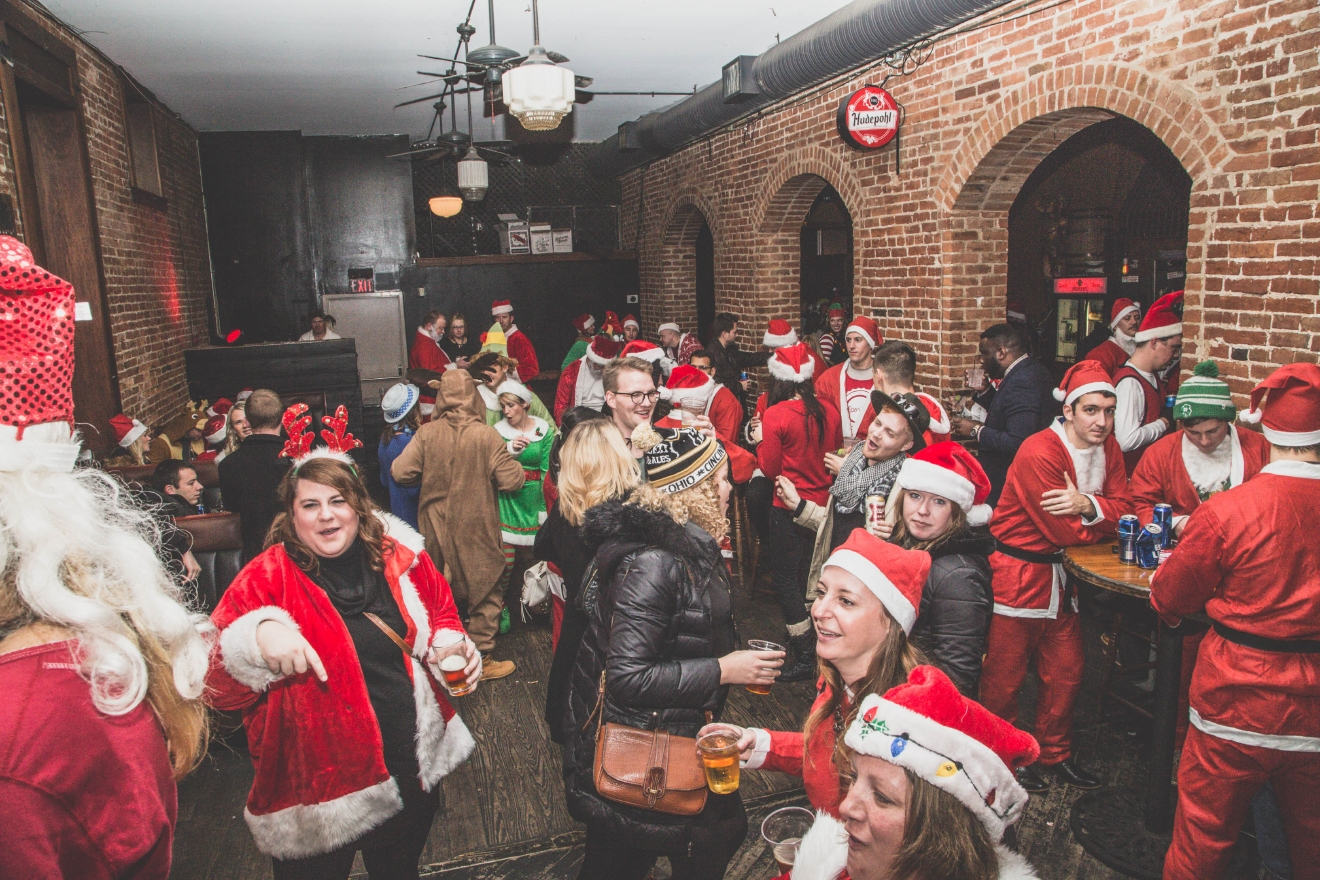 The 9th annual Cincinnati Santacon (a pub crawl where thousands of people dress like Santa) took over Downtown and Over-the-Rhine on Saturday, Dec. 10. / Image: Catherine Viox