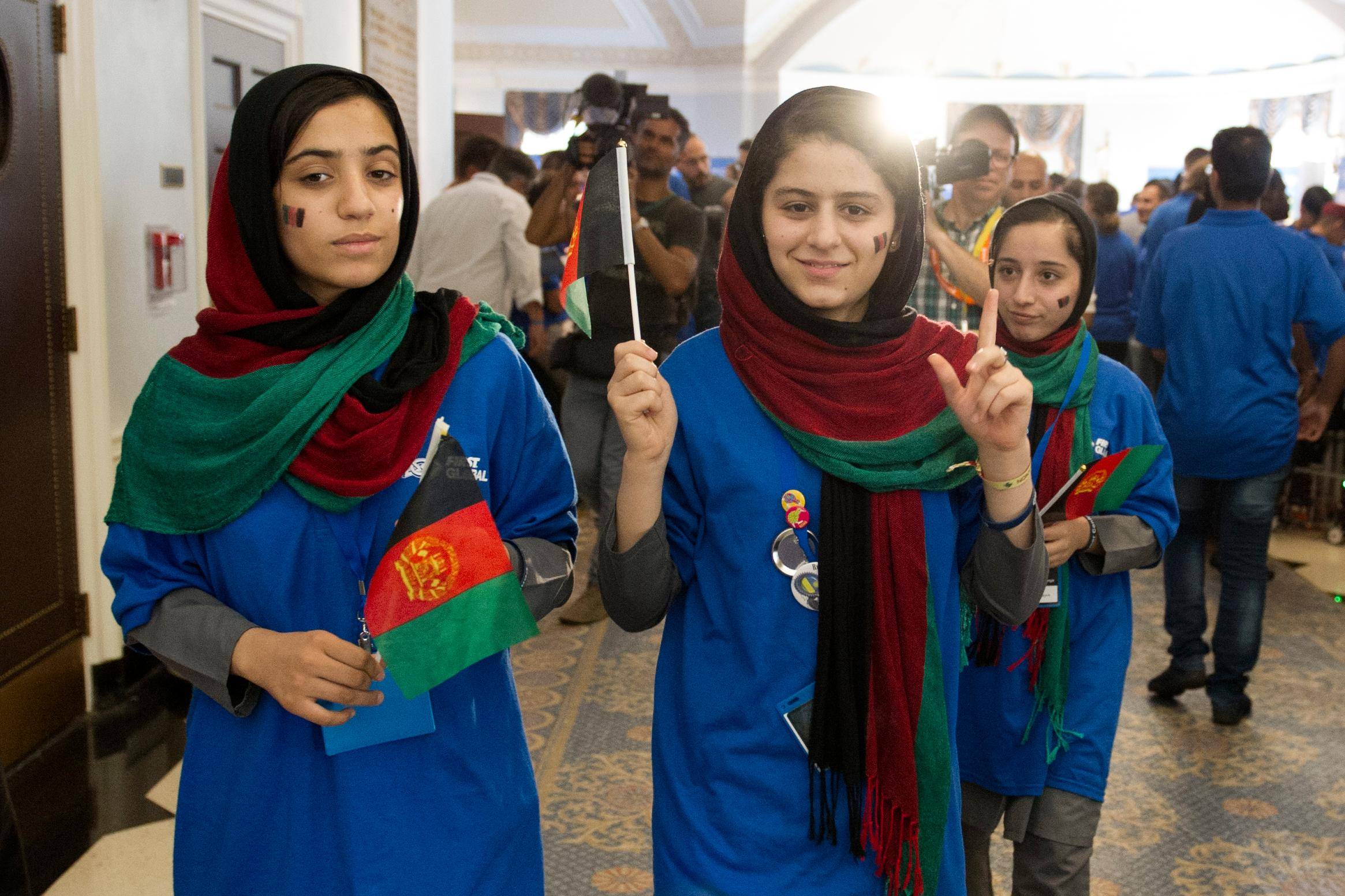 Afghanistan team member Kwasar Rashan, center, walks with her teammates to line-up for the opening ceremony march of the FIRST Global Challenge 2017, in Washington, Sunday, July 16, 2017. Twice rejected for U.S. visas, the all-girls robotics team from Afghanistan arrived in Washington early Saturday after an extraordinary, last-minute intervention by President Donald Trump. (AP Photo/Cliff Owen)