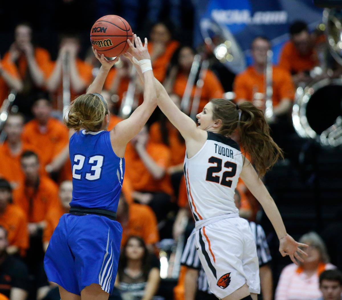 Creighton's Marissa Janning (23) has her shot blocked by Oregon State's Kat Tudor (22) during the first half of a second-round game in the NCAA women's college basketball tournament Sunday, March 19, 2017, in Corvallis, Ore. (AP Photo/ Timothy J. Gonzalez)