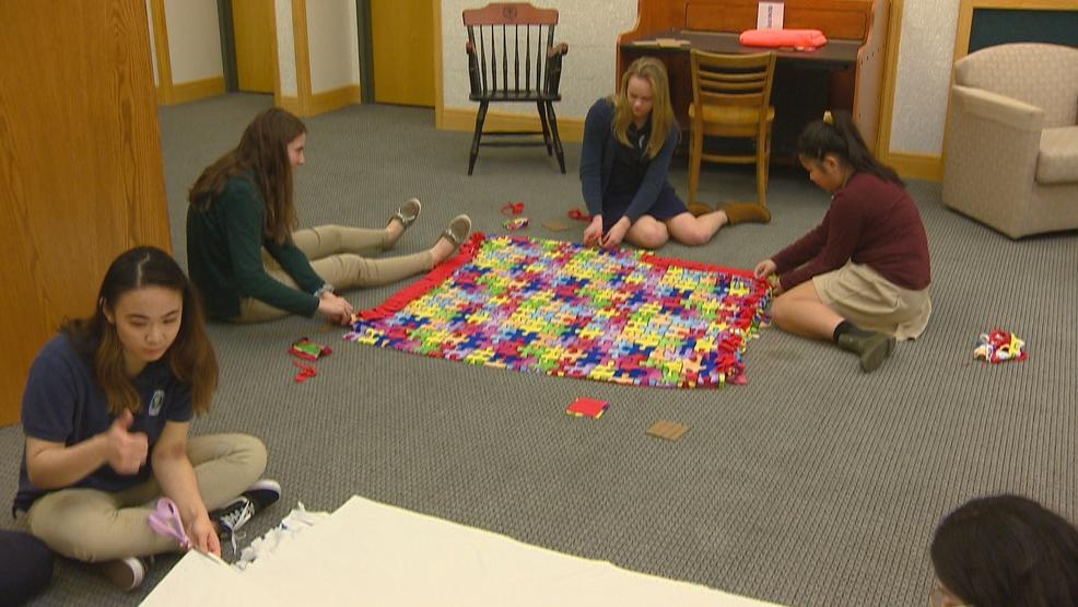 students make blankets for children at hospital wluk