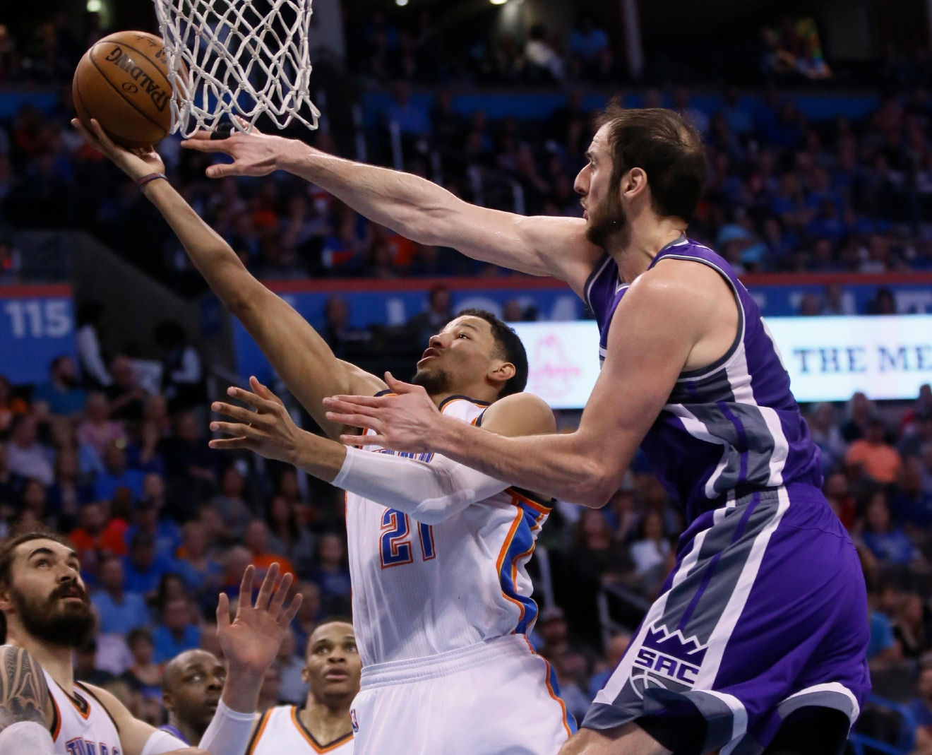 Sacramento Kings center Kosta Koufos, right, defends as Oklahoma City Thunder forward Andre Roberson (21) shoots in the second quarter of an NBA basketball game in Oklahoma City, Saturday, March 18, 2017. (AP Photo/Sue Ogrocki)
