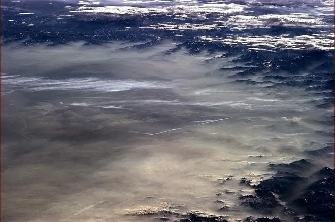 A springtime haze laps on the evening shore of the Alps.  (Photo & Caption: Col. Chris Hadfield, NASA)