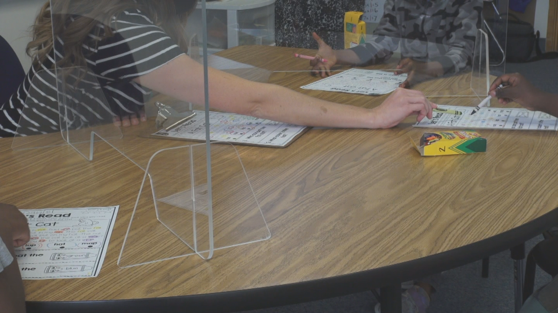 For 30 minutes a day, Laura Pawlowich works with a small group of students to help them learn English. With just her eyes visible, she said she has to work harder to communicate with her students and to make sure they're understanding what she is teaching. (KUTV)