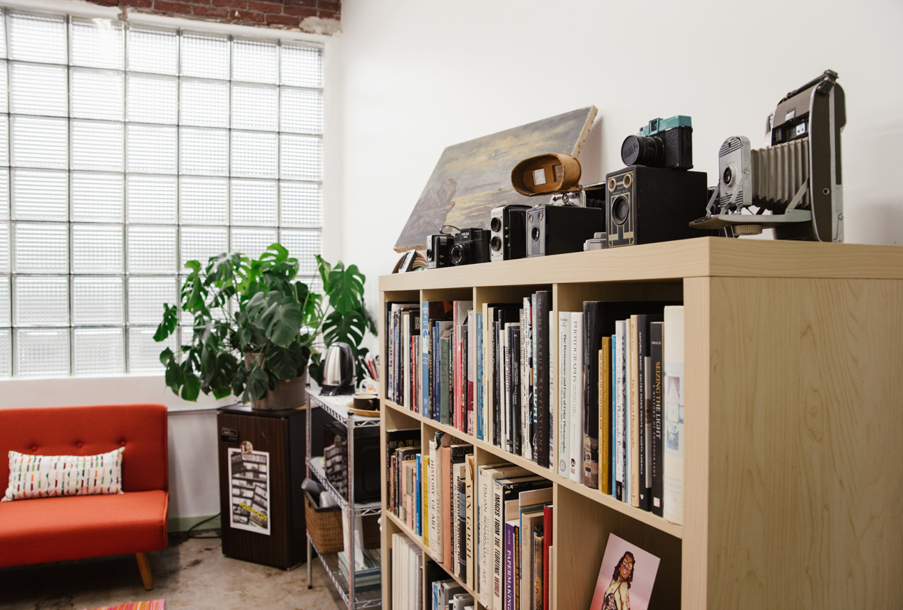 The back of the Strange Stock studio is a cozy haven of art, history books, and a fascinating collection of antique cameras. / Image: Melissa Sliney{ }// Published: 9.7.19