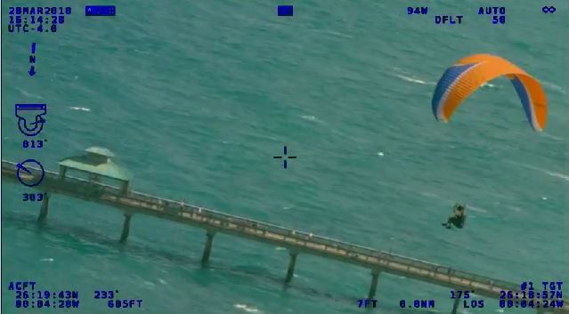PBSO helicopter video shows the effort to ground a paraglider who flew into controlled airspace in Boca Raton. (PBSO)