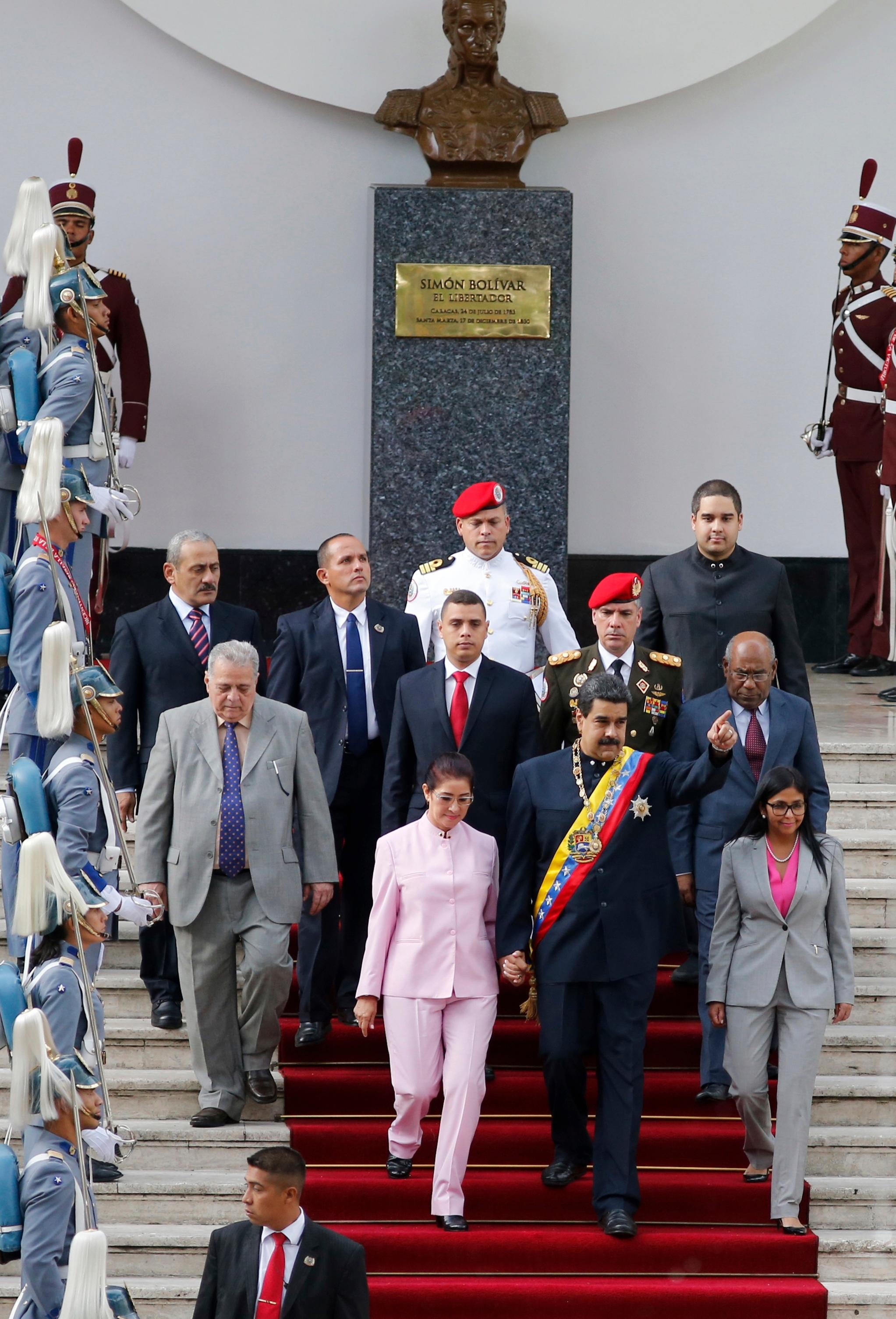 Venezuela's President Nicolas Maduro, center, flanked by his wife Cilia Flores, left, and Constitutional Assembly President Delay Rodriguez, arrive to the National Assembly building to attend a special session of the constitutional assembly in Caracas, Venezuela, Thursday, Aug. 10, 2017. The new constitutional assembly has declared itself as the superior body to all other governmental institutions, including the opposition-controlled congress. At top is a bust of the nation's independence hero Simon Bolivar. (AP Photo/Ariana Cubillos)