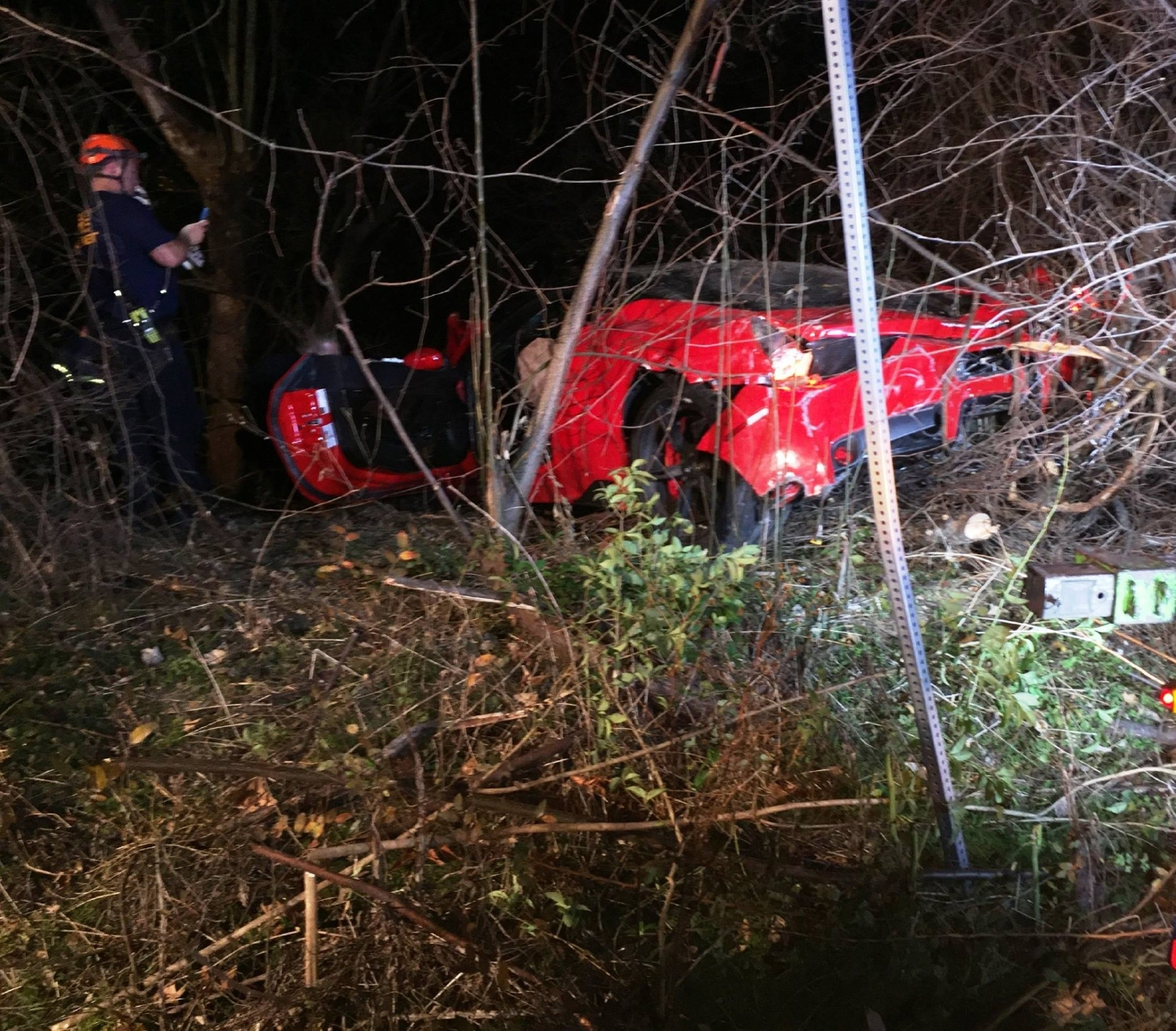 The Austin Fire Department says a limited-edition Ferrari worth $385,000 ended up at the bottom of a ravine in West Austin, Texas after the driver failed to make a turn at high speed and sent the car airborne. (AFD Battalion Chief David Brietzke)