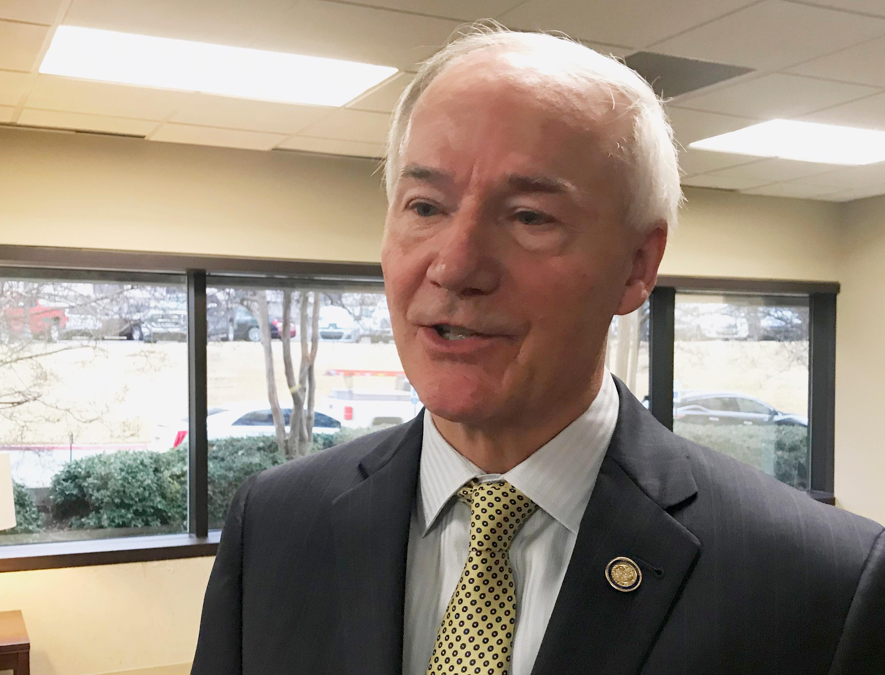 =FILE - In this Jan. 9, 2018, file photo, Arkansas Gov. Asa Hutchinson speaks to reporters in Little Rock, Ark., about his proposed budget for the coming fiscal year. The Republican governor has proposed adding a work requirement to the state's hybrid Medicaid expansion. GOP leaders from several states are cheering the Trump administration's decision to allow such requirements for Medicaid. (AP Photo/Andrew DeMillo, File)