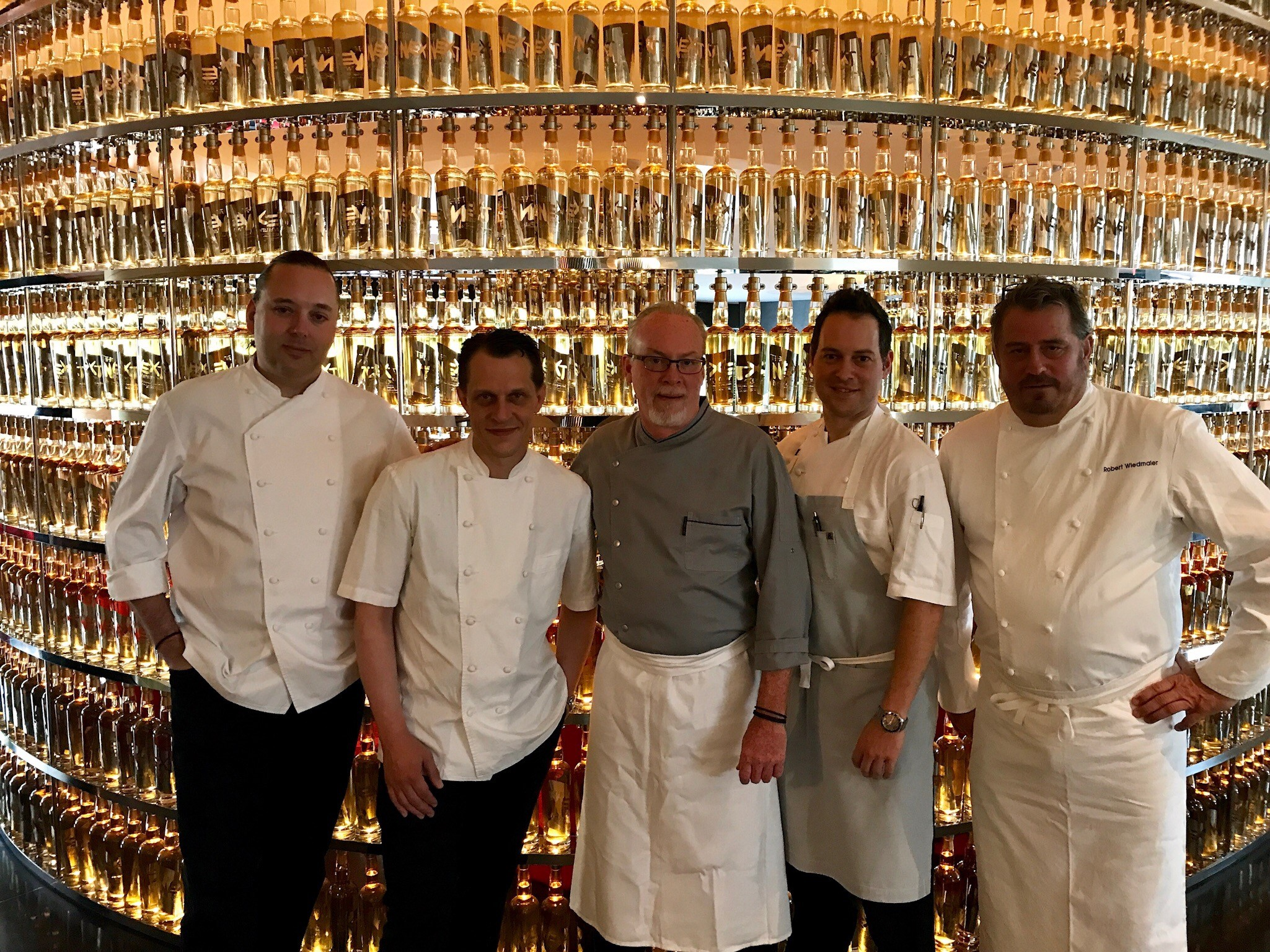 Chef Paul Liebrandt, Chef Michael Laiskonis, Chef Brian McBride, Chef Michael Santoro and Chef Robert Wiedmaier in front of The Next Whisky Bar. (Image: Courtesy The Watergate Hotel)