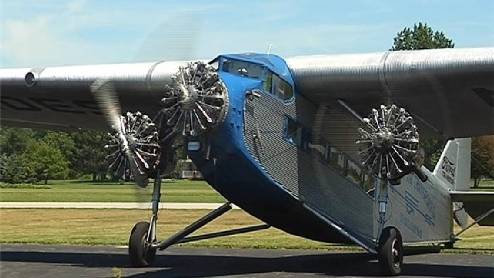 A 1929 Ford Tri-Motor airplane prepares to take off from Sandusky Airport.