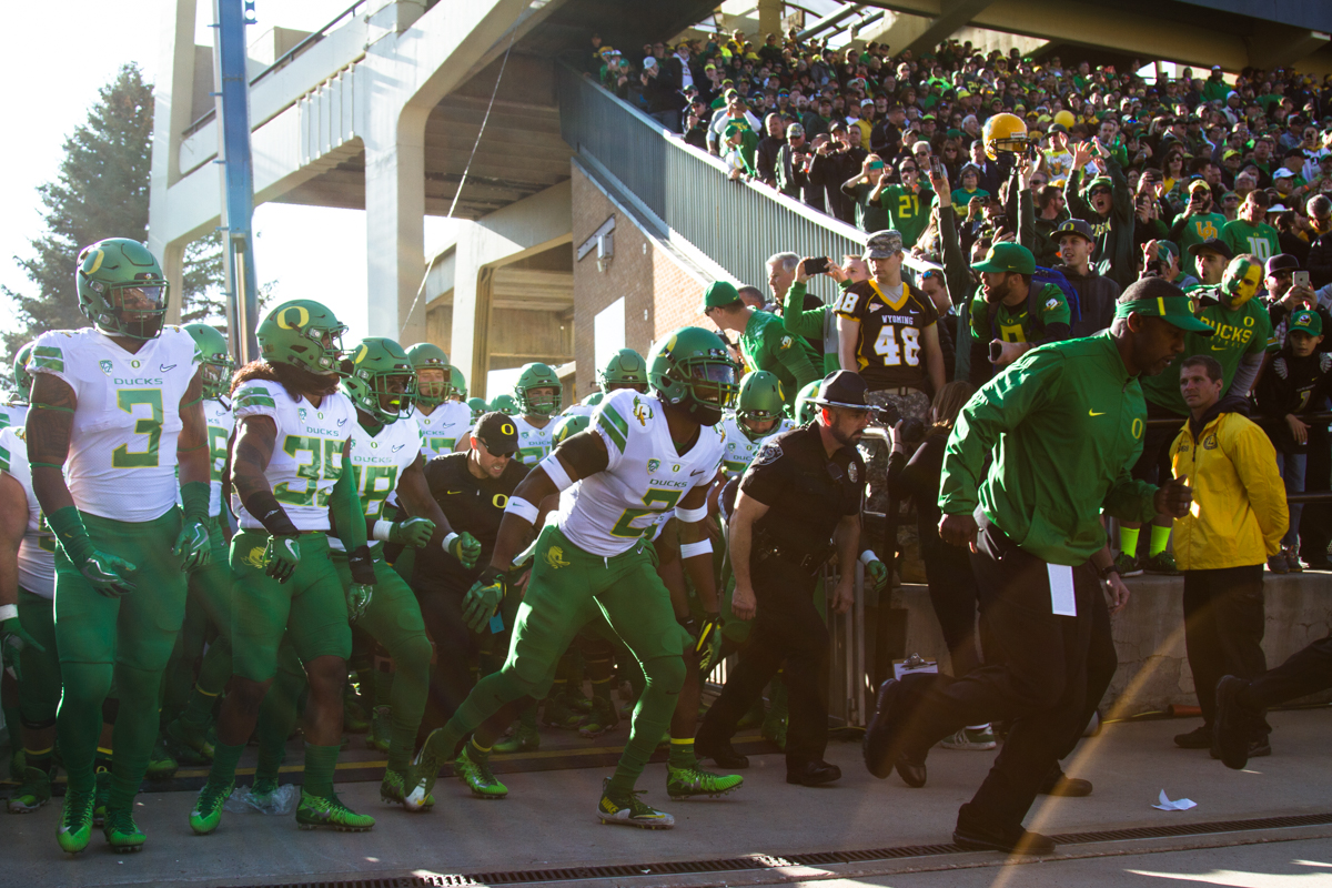 The Oregon Ducks follow head coach Willie Taggart onto the field before the opening kickoff. The Oregon Ducks lead the Wyoming Cowboys 42 to 10 at the end of the first half on Saturday, September 16, 2017 in Laramie, Wyo. Photo by Austin Hicks, Oregon News Lab
