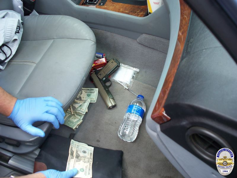 Police obtained a search warrant for Clayton Smith's 2002 BMW and found $5,400 cash, 123 grams of heroin, 76 grams of meth, packing materials and a loaded .45 caliber handgun. (Keizer Police photo)