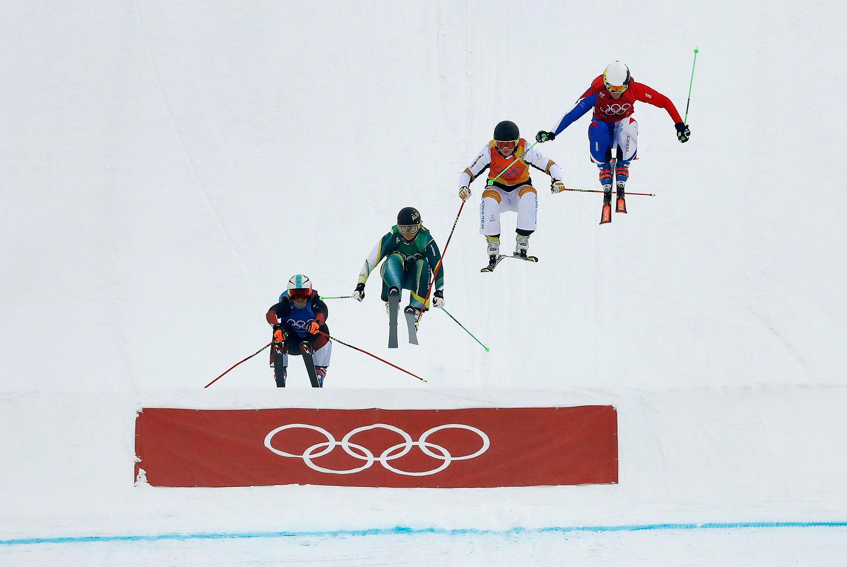 From left; Sanna Luedi, of Switzerland, Sami Kennedy-Sim, of Australia, Lisa Andersson, of Sweden, and Alizee Baron, of France, run the course during the women's ski cross small final at Phoenix Snow Park at the 2018 Winter Olympics in Pyeongchang, South Korea, Friday, Feb. 23, 2018. (AP Photo/Kin Cheung) (AP Photo/Lee Jin-man)
