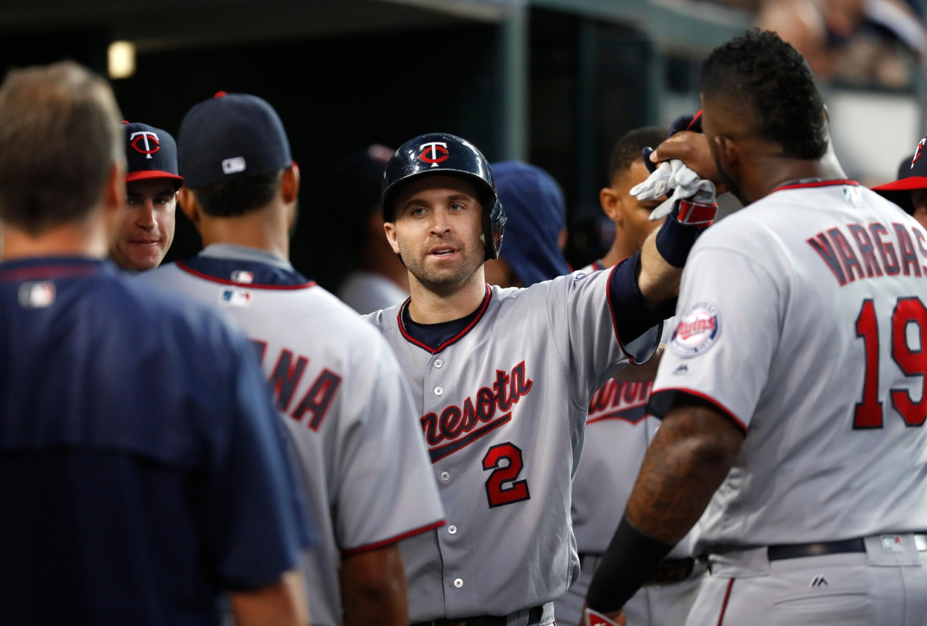 Minnesota Twins' Brian Dozier (2) celebrates his solo home run against the Detroit Tigers in the third inning during a baseball game in Detroit, Monday, Sept. 12, 2016. (AP Photo/Paul Sancya)