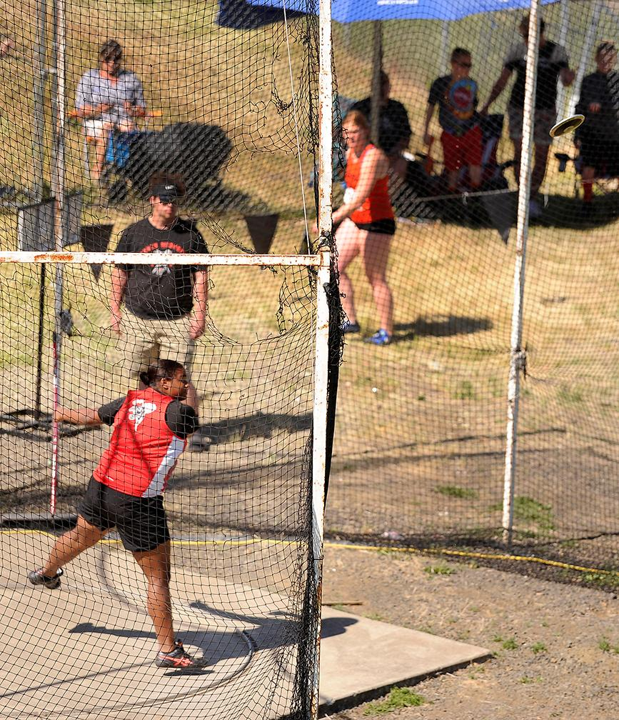 Andy Atkinson / Mail TribuneNorth Medford's Jaida Ross makes a throw in the finals winning the girl discus throw at the SWC Championships meet at North Medford High School Saturday.
