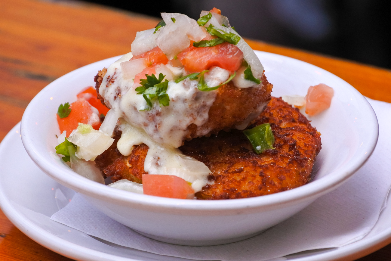 "Arnold's ""Fried Green Tomatoes"" (breaded green tomatoes, fried pepperjack cheese, pico de gallo green, and tabasco cream) / Image: Phil Armstrong, Cincinnati Refined // Published: 1.3.17"