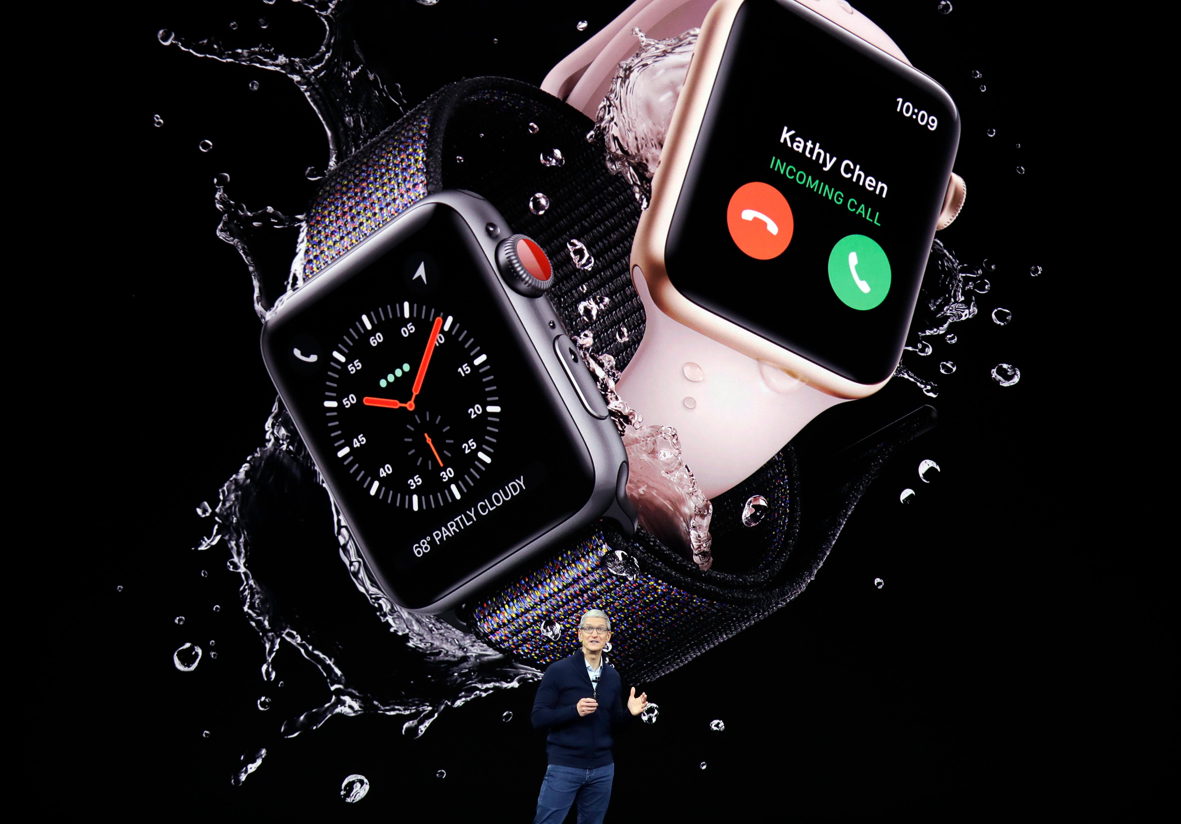 Apple CEO Tim Cook, shows new Apple Watch Series 3 product at the Steve Jobs Theater on the new Apple campus on Tuesday, Sept. 12, 2017, in Cupertino, Calif. (AP Photo/Marcio Jose Sanchez)