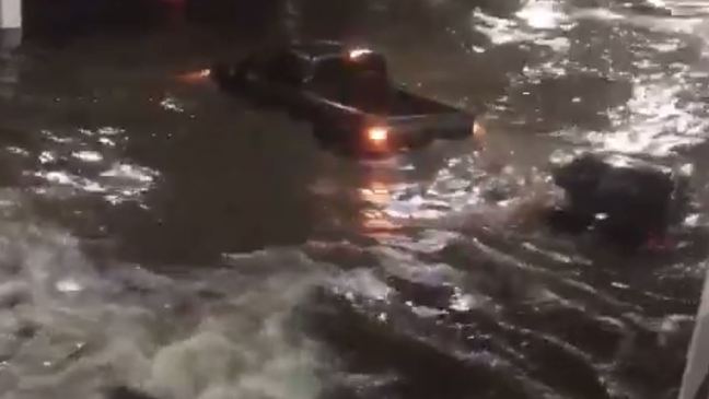 WATCH: Storm surge swamps cars in Biloxi