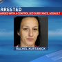 Woman charged after needle sticks jailer