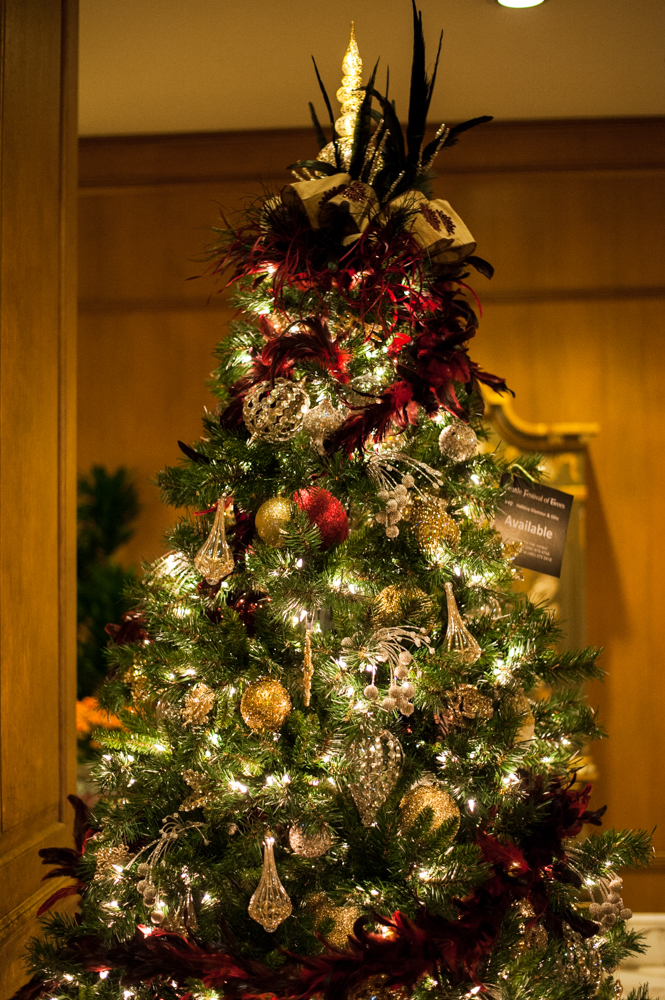 <p>Holiday Glamour & Glitz- 7.5 feet tall, a Hollywood-themed tree.. Located in the Fairmont Olympic Hotel in downtown Seattle, the annual Festival of Trees has officially kicked off this holiday season. Patrons can view the trees on display through December 2, 2018 - or bid on them for their home/office. Proceeds benefit Seattle Children's Hospital. (Image: Elizabeth Crook / Seattle Refined)</p>