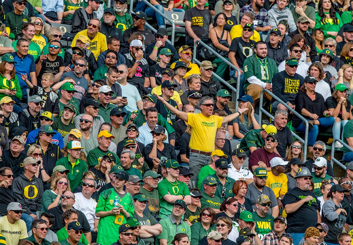 A man in the crowd expresses his displeasure at the referees call. The Oregon Ducks broke their losing streak by defeating the ASU Sun Devils on Saturday 54-35. Photo by August Frank, Oregon News Lab