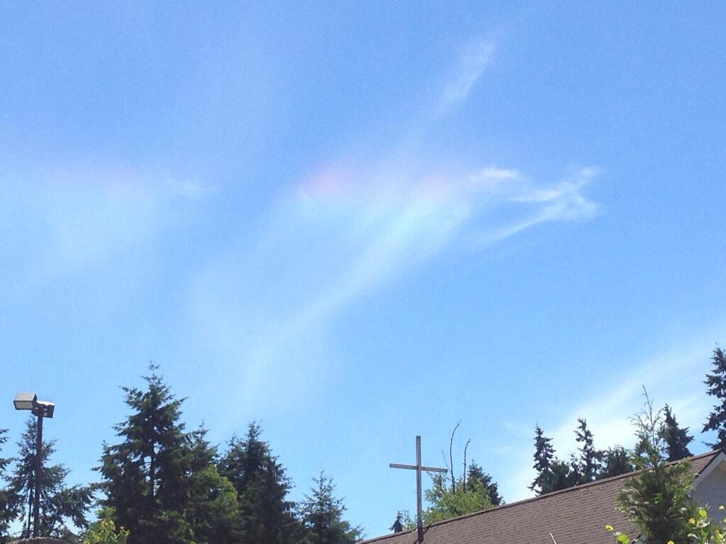 "These colorful clouds are called ""Circumhorizontal arcs"" or, more informally, ""Fire Rainbows."" They're caused by the ice crystals in the cloud being at just the correct angle to the sun to refract the light into the colors of the rainbow. More details here:. (Photo courtesy: Bryan Riley. July 1, 2014)"