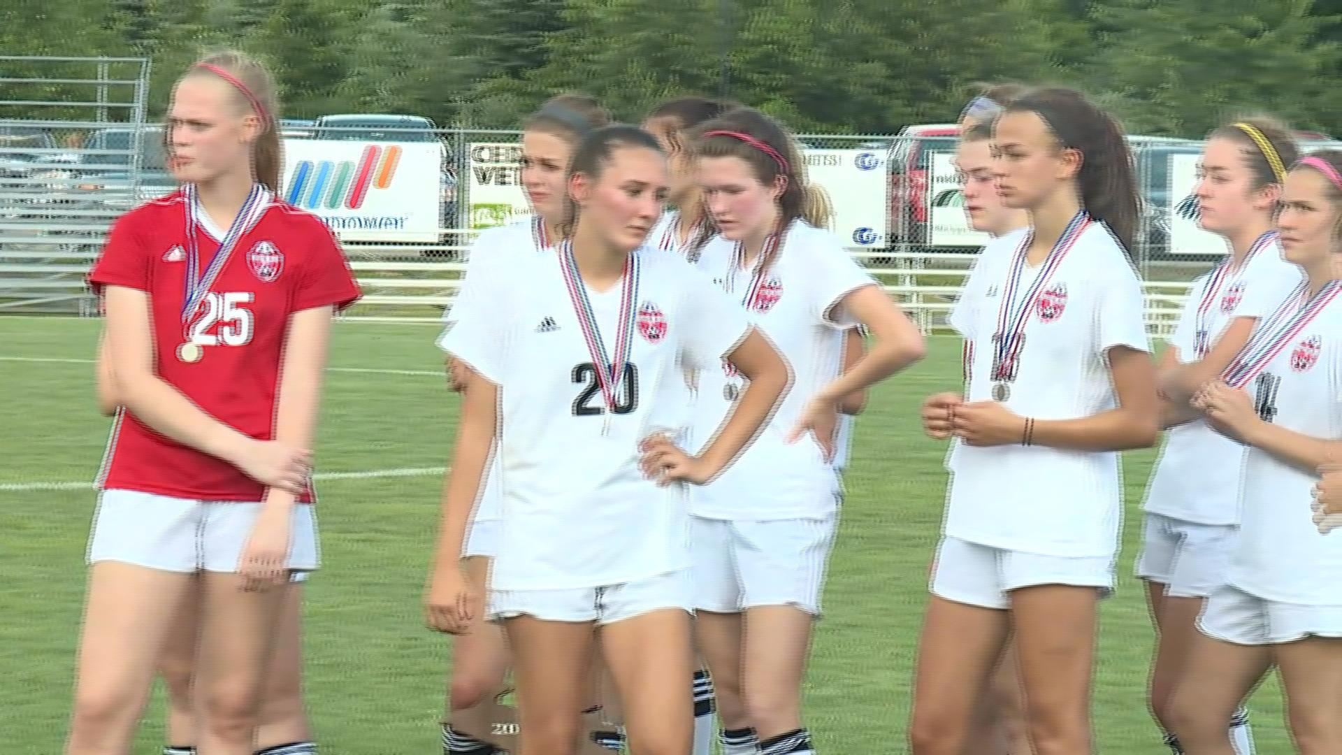 Grand Blanc girls soccer team accepts their medals as the state runner up after a loss in the state championship game.