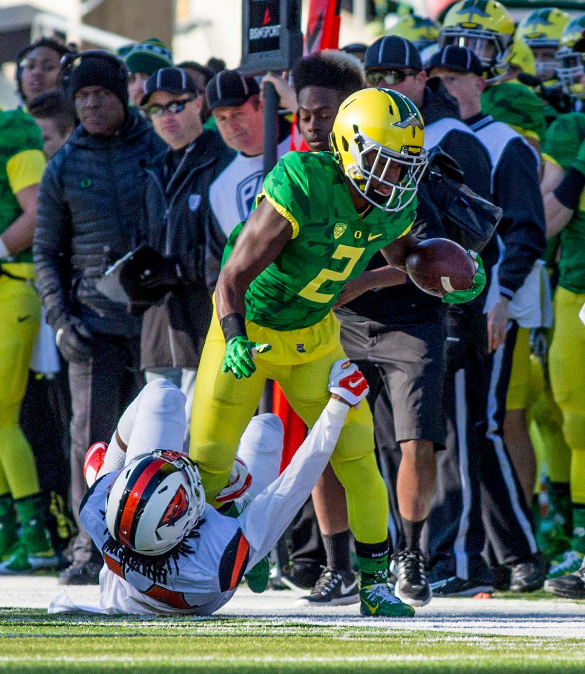 Oregon Ducks Braylon Addison (#2) drags the Oregon State Beavers defender in the Civil War game in Autzen Stadium. At the half the Ducks led the Beavers 31 - 7. Photo by Katie Pietzold, Oregon News Lab