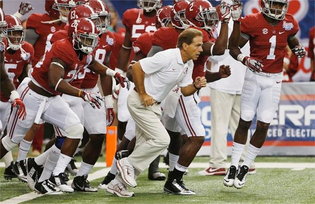 Alabama head coach Nick Saban his team take the field to warm up before an NCAA college football game against West Virginia Saturday, Aug. 30, 2014, in Atlanta.
