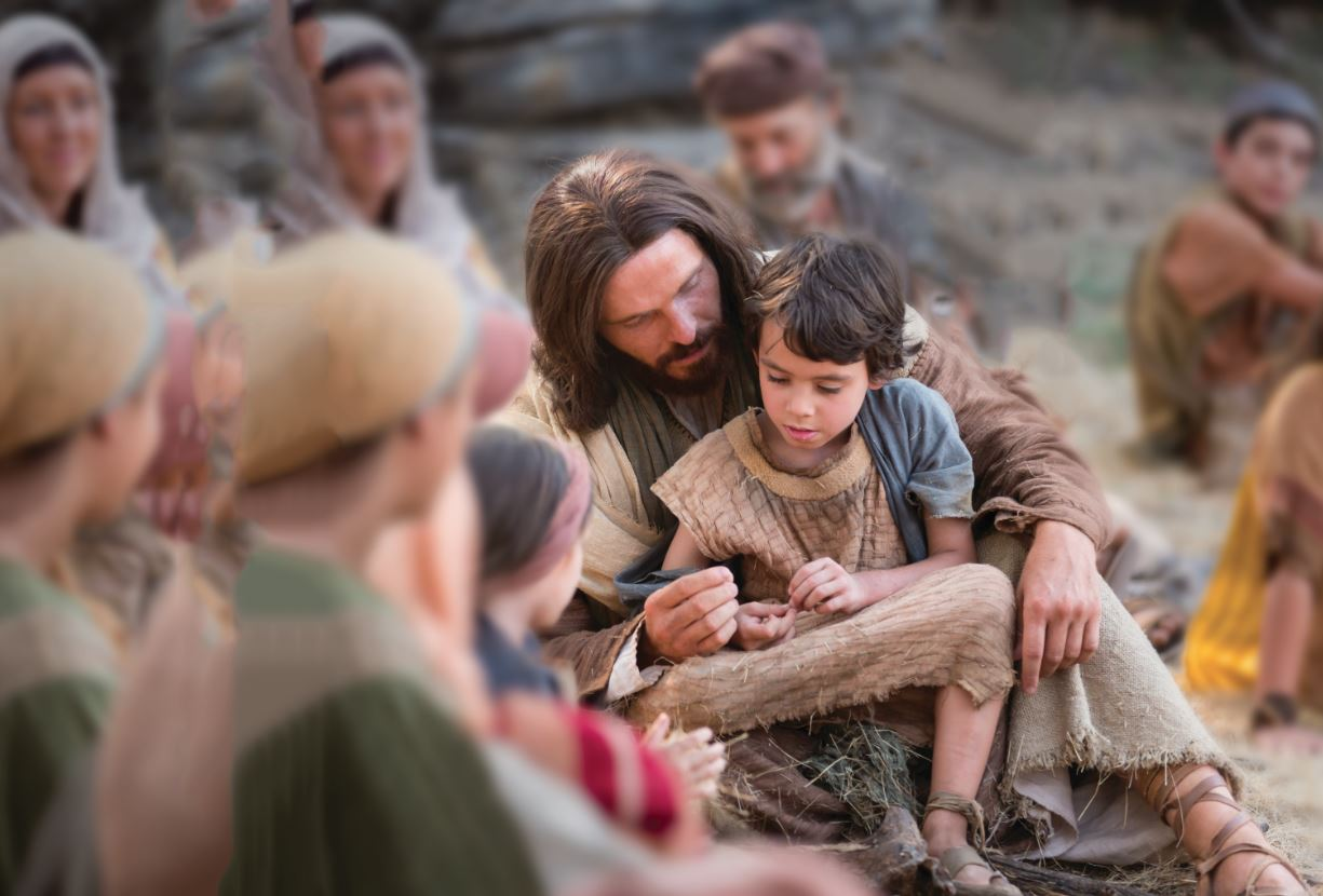 "Photo released with Friday's LDS church news statement. ""A depiction of Jesus Christ with a child."" (Photo: Intellectual Reserve Inc.)"