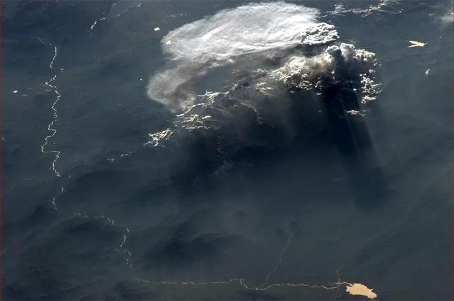 Shadow play of cloud and mountain at sunset.  (Photo & Caption: Col. Chris Hadfield, NASA)