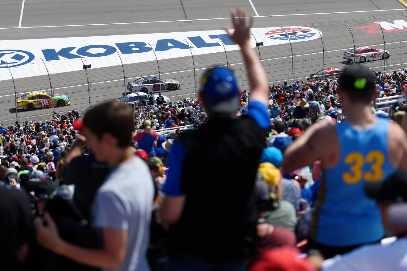 Fans wave as their favorite cars pass by during the Monster Energy NASCAR Cup Series Kobalt 400 Sunday, March 12, 2017, at the Las Vegas Motor Speedway. (Sam Morris/Las Vegas News Bureau)