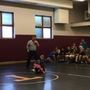 WATCH: Boy runs to sister's rescue during wrestling match
