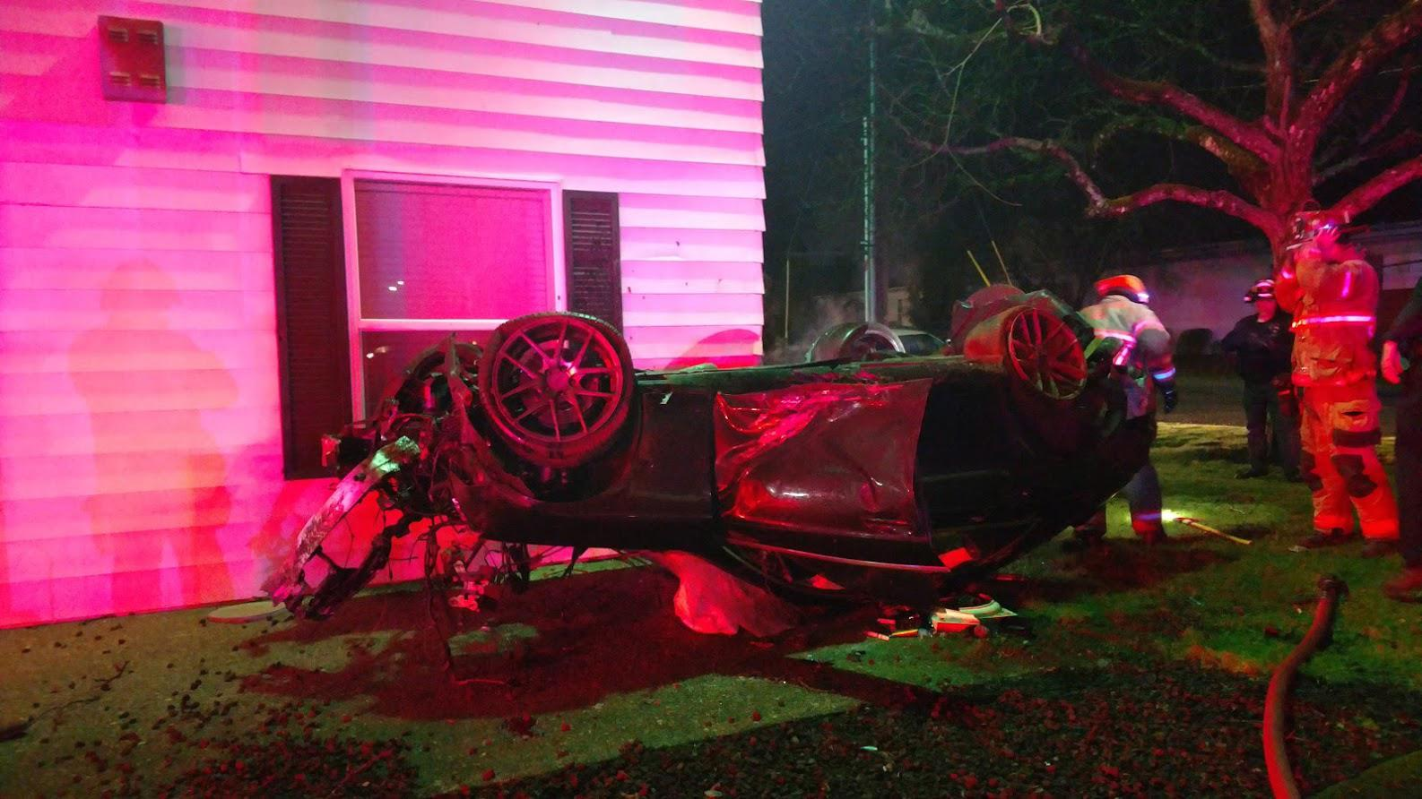 Firefighters say a driver rolled this car several times and ended up near this building near Southeast 182nd Avenue and Yamhill Street on Monday night, Dec. 23, 2019. (Photo Gresham Fire Department)
