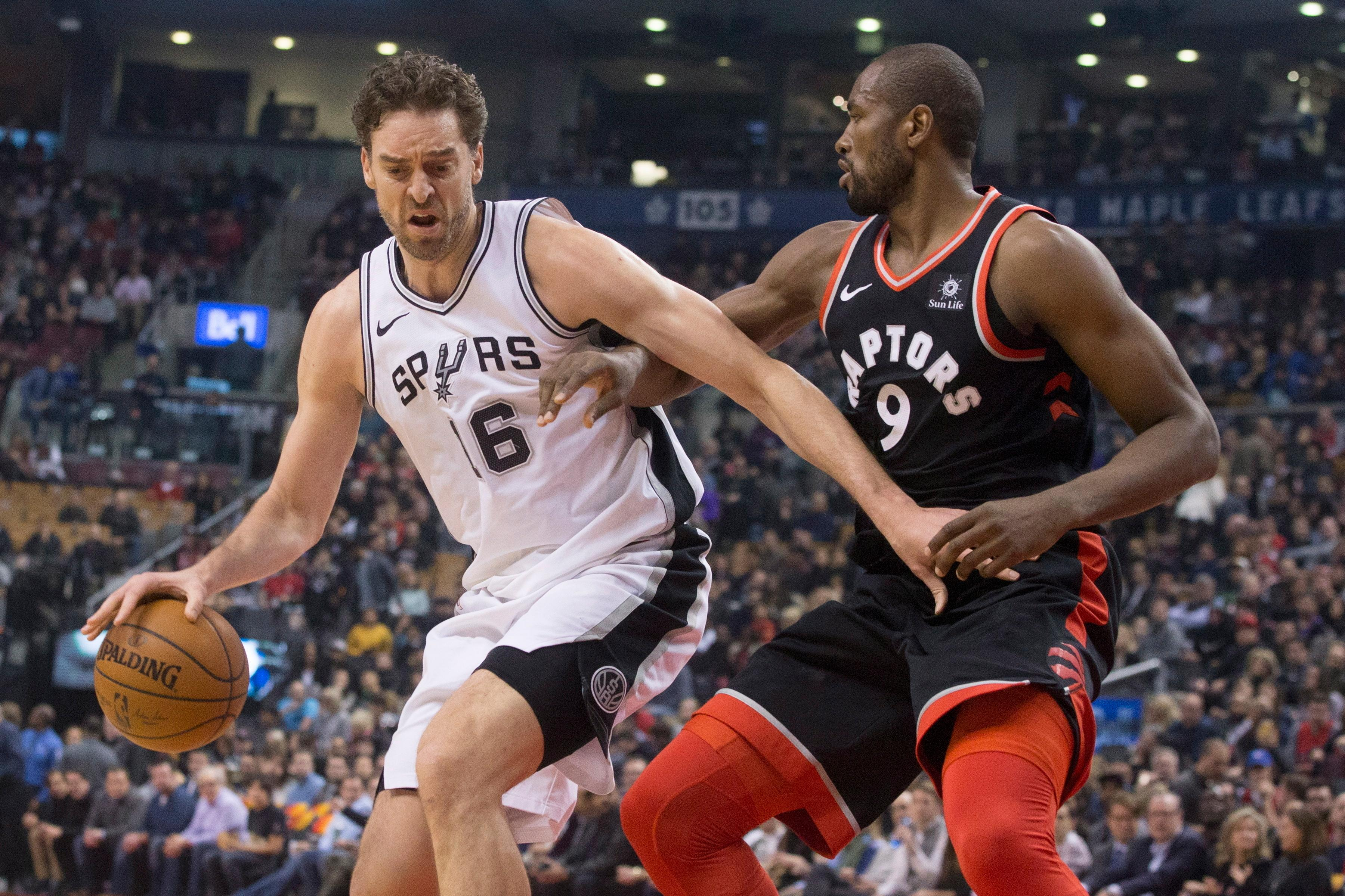 San Antonio Spurs center Pau Gasol (16) works against Toronto Raptors forward Serge Ibaka (9) during the first half of an NBA basketball game Friday, Jan. 19, 2018, in Toronto. (Chris Young/The Canadian Press via AP)