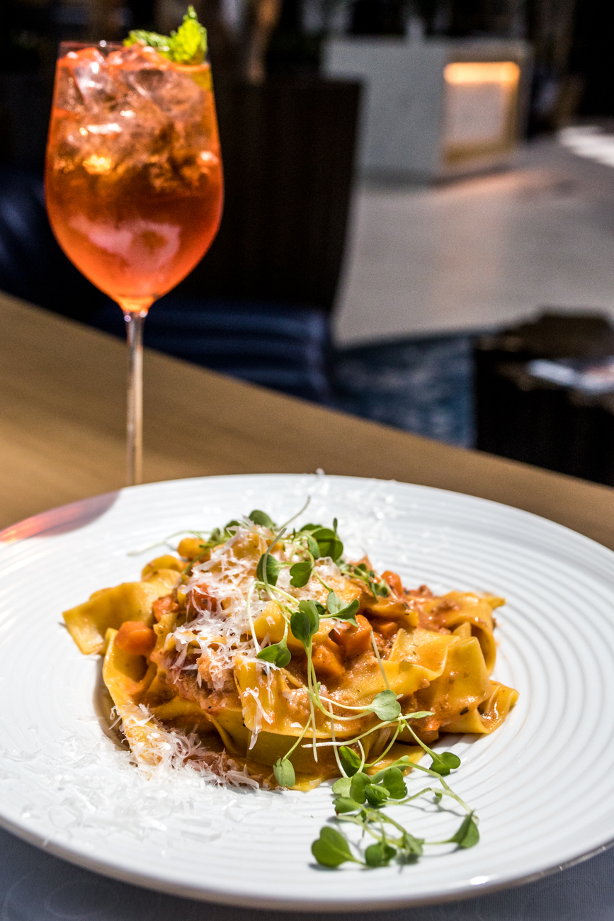 Pappardelle Bolognese: ground pork and beef, San Marzano tomato, red wine, basil, and Pecorino Romano paired with the Taft Toast / Image: Catherine Viox{ }// Published: 6.22.20